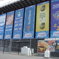 Custom Mesh Banners Hanging Outside Stadium